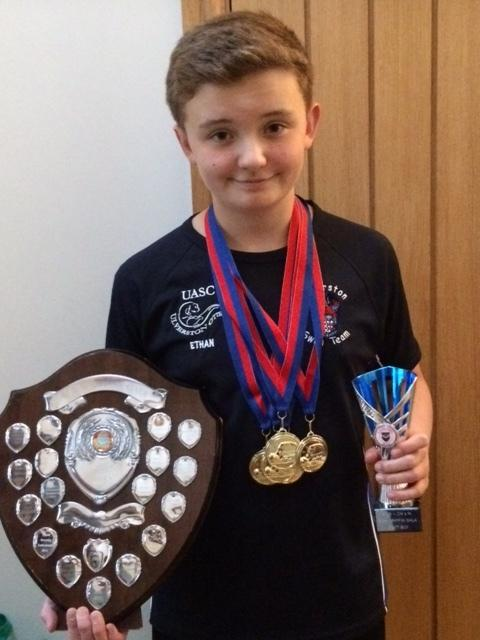 Ethan Alpress with his trophies