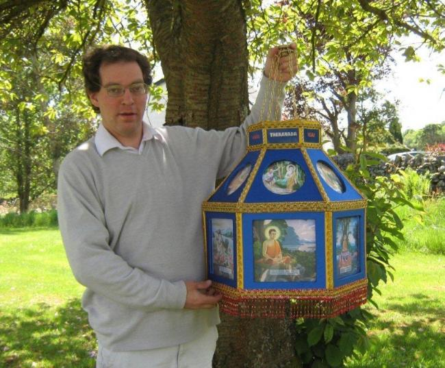 Duncan Fisher with a traditional Vesak lantern decorated with scenes from the life of the Buddha, which he made and presented to the Buddhist Group of Kendal