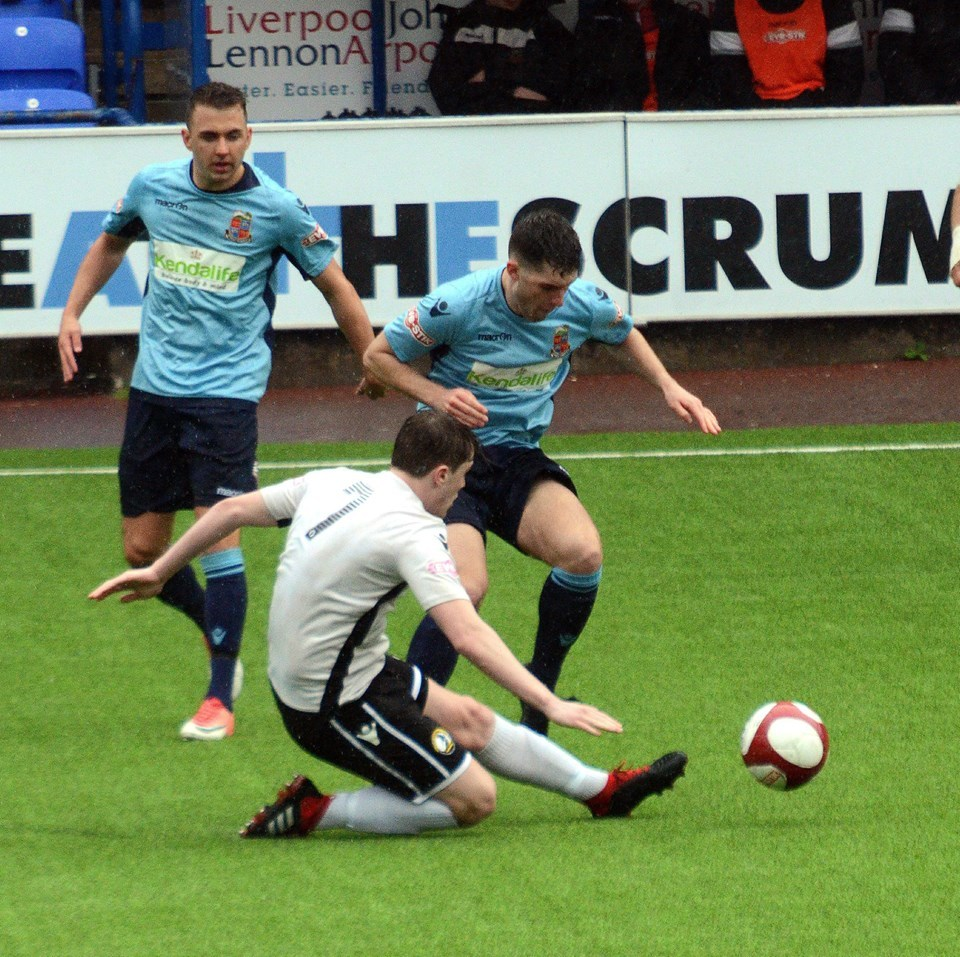 Action from Kendal Town's game at Widnes. Pic: Chris Wrigley