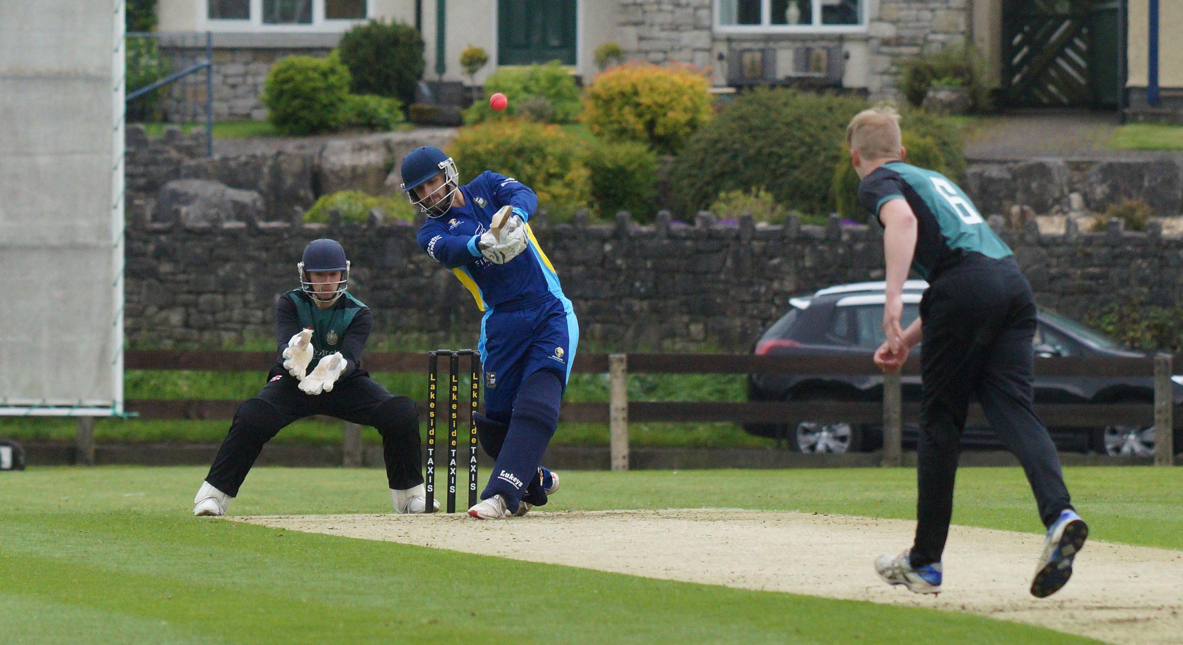 Lewis Edge slams a six in Netherfield's T20 win over Penrith. Pic: Richard Edmondson