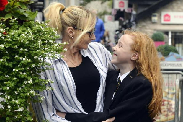 Angela Proctor of Grange with her caring daughter Kacey. Photo: JON GRANGER