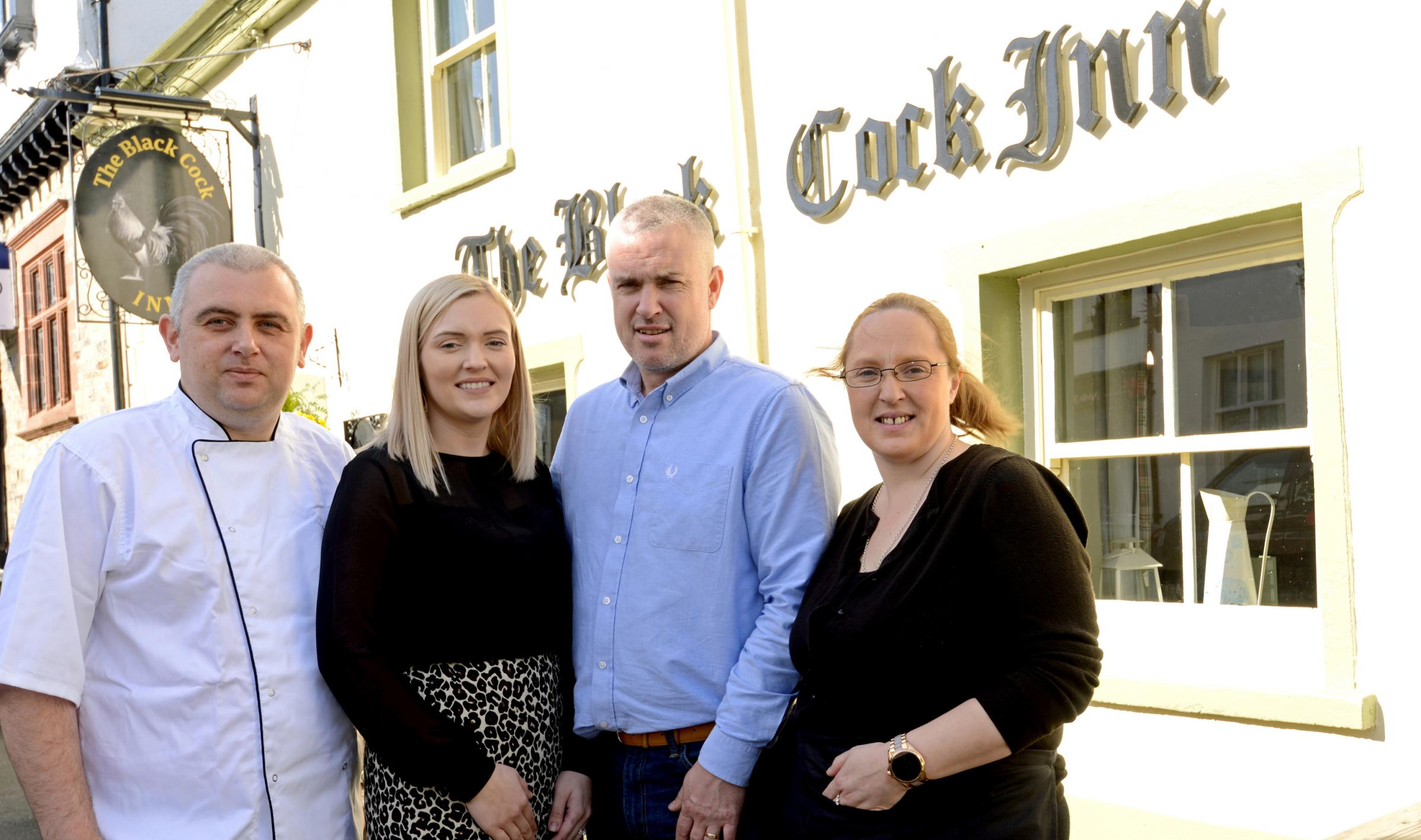 Chef Rob Phillips, Lakeland Inns owners Kirsty and Scott Mackenzie, and manager Hayley Stead outside The Black Cock Inn, Broughton-in-Furness, Cumbria.