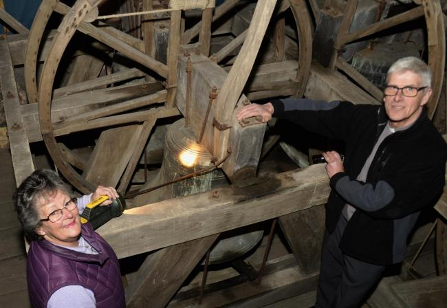Judy Dobson with vicar Rev Sam Held in the church tower. Picture: JON GRANGER