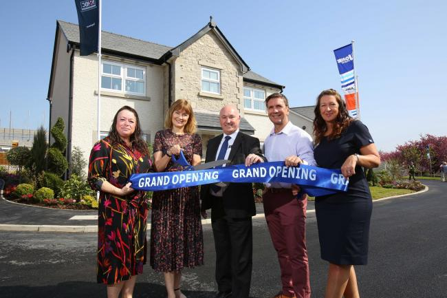 The grand opening of the new show homes at Stonecross Meadows in Kendal, with Jones Homes regional director Ralph Bacon (centre) flanked by two of the first residents to move into the development, Debbie and Alan Robertson, joined by sales director Carol