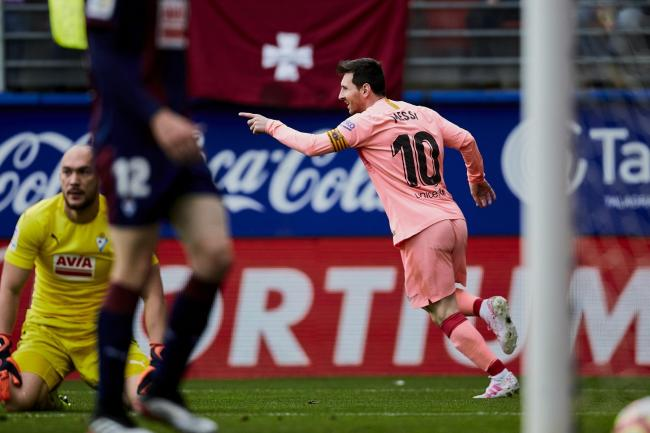 Lionel Messi struck twice in as many minutes against Eibar