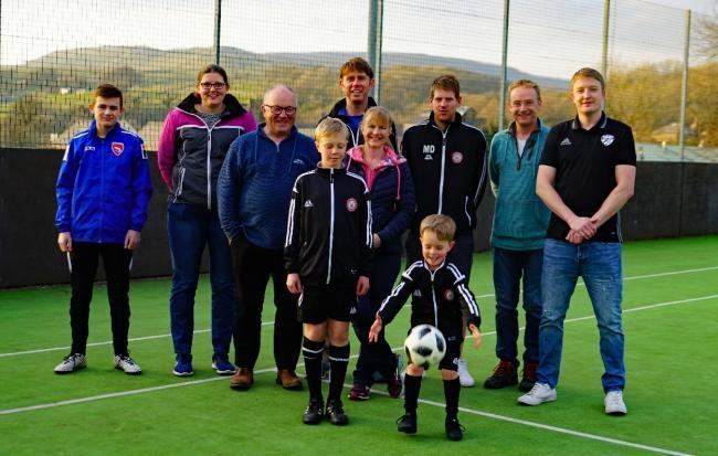 Organisers of Ingleton MUGA fundraising campaign with three junior members. David McGonnigal, third from left