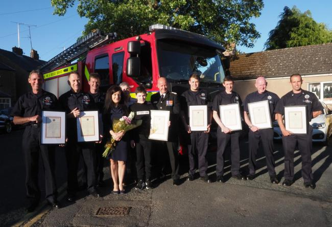 Appleby fire crew are presented with certificates of commendation, with Kacper Krauze and his family in attendance
