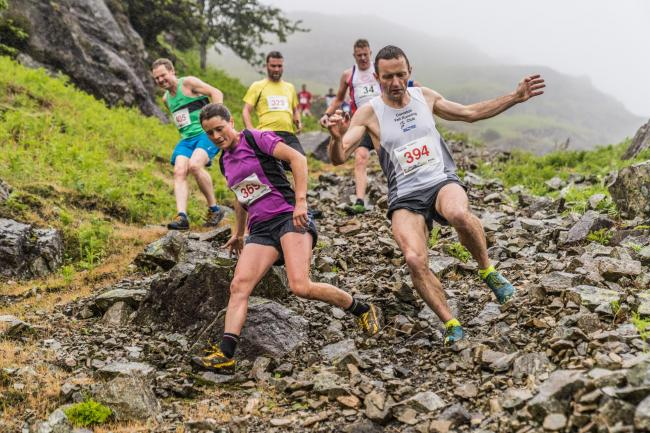 Robert Crawford (394), of Howgill Harriers; unattached Kate Davies (369) and Black Combe's John Millen (405) descending at Coniston Gullies on Sunday